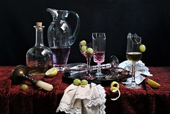 The Party Is Over (Esther Spektor - Thanks for 12+millions views..) Tags: stilllife naturemorte bodegon naturezamorta stilleben naturamorta composition creativephotography artisticphoto arrangement tabletop party leftovers food grape lemon slice wine alcohol bottle pitcher goblet broken candlestick napkin tray candle glass metal velvet availablelight reflection green yellow pink golden red white black estherspektor canon
