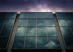 Glass (Darren LoPrinzi) Tags: 5d canon5d philadelphia philly urban canon city miii urbanexploration perspective sky clouds architectural architecturalperspective lookingup glass windows reflection reflections symmetry geometry geometric green purple nj newjersey