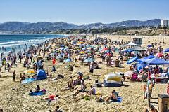 Spring at the Beach (Joe Lach) Tags: santamonicabeach santamonicabay beach sand mountain buildings umbrellas girls boys bikinis pacificocean california joelach sunbathing