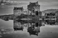 All calm at the Castle (Evoljo) Tags: eileandonan castle highlands scotland reflection water blackwhite building nikon d500