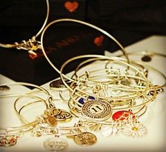 ~Baubles and bangles...~ (nushuz) Tags: smileonsaturday jewels bracelets bangle dof gold silver alexanis hearts littleblackboxes