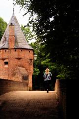 Crossing Monnickendam (Dannis van der Heiden) Tags: monnickendam bridge lady crossing brick tower blonde trees nature shadows lamp lantern slta58 amersfoort netehrlands slate historic woman persona walking