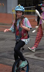 Young Unicyclist (swong95765) Tags: girl ride unicycle parade helmet balance young