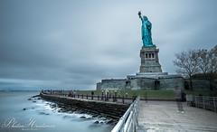 Statue of Liberty (Photon-Huntsman) Tags: newyork newyorkcity nyc new outdoor blue yellow buildings building water longexposure exposure sony sonyalpha sonya6000 sky clouds cloudy cloud