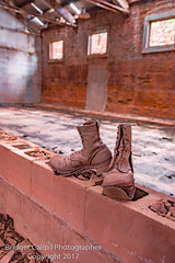If Boots Could Talk (Bridget Calip - Alluring Images) Tags: abandoned alluringimagescolorado bridgetcalip gloryhole ifbootscouldtalk iron ore sunrisemine wyoming bathhouse blueskies boots cinderblock country miningdistrict natuallight