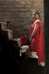 I got my red dress on tonight (alfienero) Tags: woman red india asia portrait lady elegance dark light