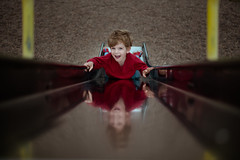 Feet first. (kate.millerwilson) Tags: slide portrait playground lines reflection happy red