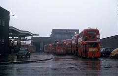 Hounslow bus Garage, 1973 (Lady Wulfrun) Tags: 1973 hounslow bus garage lt rt rf londontransport 1970s 1960s london britain uk morrisminor 1000