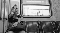 Quickie on the metro!! (Baz 120) Tags: candid candidstreet candidportrait city candidface candidphotography contrast colour street streetphoto streetcandid streetphotography streetphotograph streetportrait rome roma romepeople romestreets romecandid europe women monochrome monotone mono blackandwhite bw noiretblanc urban voigtlandercolorskopar21mmf40 voightlander leicam8 leica life primelens portrait people unposed italy italia girl grittystreetphotography flashstreetphotography flash faces decisivemoment strangers