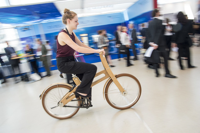 Touring the exhibition by wooden bike