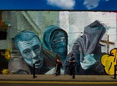 Whoever kisses time's ancient nodding head (Steve Taylor (Photography)) Tags: art graffiti mural streetart men uk england london osipmandelstam cross reaper hoodie mask talking bollard grimreaper