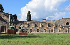 Fractured Sculpture, Pompeii (meg21210) Tags: pompeii naples campania italy italia cosmos tour fall2016 sculpture fractured man contemporary exhibit columns ancient roman walls wall stone grass sky clouds trees tree