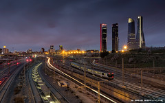 Running Out Of Time :: DRI (servalpe) Tags: chamartin ef1635mmf4lisusm city cityscape canon 1635 kio lights servalpe 5dmarkiii cuatrotorresbusinessarea bluehour towers skyscrapers trains architecture madrid trails canoneos5dmarkiii outdoors ctba comunidaddemadrid spain es