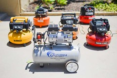 group of air compressors in a driveway