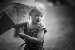 Li'l Darlin' (Danny Shrode) Tags: girl umbrella monochrome rain child outdoor blackandwhite portrait