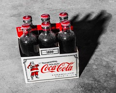 Coca Cola Christmas (anthonysama) Tags: holidays holiday christmas santa glassbottles glassbottle glass cokebottles oldbottles classicbottles classic commercialphotography commercial find dusty old retro vintage antique collectorsitem fineart contrast red monochrome bnw blackandwhite art soda cocacola coke