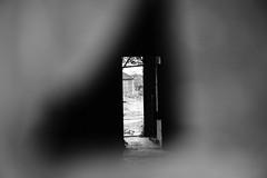 Nobody there...?! (Ir3nicus) Tags: neukirchenvluyn nordrheinwestfalen deutschland zecheniederberg germany nikon d700 dslr fullframe bw blackandwhite schwarzweis tür door hole loch peepthrough dark contrast