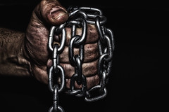 Hand with CHAIN (sergeitukach) Tags: criminal metal prisoner chain hand steel jail arrest crime freedom law bondage chained lock punishment slave background violence fist iron isolated symbol man prison human padlock social security male police trapped concept concepts captured people victim chains secure white link pain convict hostage justice legal liberty metallic person thief hands