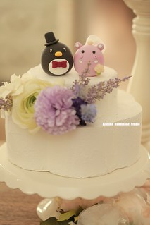 Hippo and penguin wedding cake topper