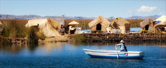 The Reed Islands (kate willmer) Tags: water lake island houses boat person reeds huts blue titicaca peru