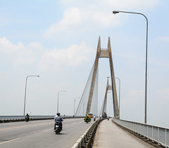 Traffic on the Binh Bridge in Hai Phong, Vietnam (phuong.sg@gmail.com) Tags: architecture asia big blue bridge building cable city clear concrete construction cross design engineering haiphong hanging high highway infrastructure landmark large light longest metal modern motorbike outdoor people road sky south stayed steel structure suspended suspension tall tower traffic transport transportation travel vietnam view