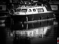 Boat with Reflection (BigRedTroll) Tags: bw blackandwhite boat contrast contrasty england marina monochrome northampton reflection transport vehicle vignette water