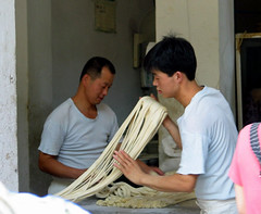 noodle making - Xi'an, China (Russell Scott Images) Tags: streetscenes xian china