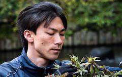 2017 - Yokohama  - Hase - Hase-dera Temple - Gardener - 3 of 11 (Ted's photos - Returns Late November) Tags: japan nikon nikond750 nikonfx tedmcgrath tedsphotos vignetting yokohama 2017 cropped male man boy portrait face gloves bokeh hasederatemple hasejapan hair blackhair lips