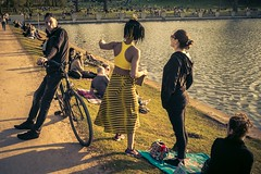 Yellow Hour (toletoletole (www.levold.de/photosphere)) Tags: cologne fujix100f köln street people menschen wasser porträt youngwoman jungefrau portrait cyclist water pond radfahrer weiher goldenhour