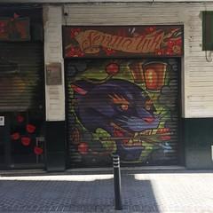 Sevilla Ink (breakbeat) Tags: seville sevilla spain espana travel holiday vacation citybreak summer tattoo shop painted graffiti shutters panther illustration image cruzcampo sign ink
