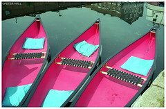 Three Pink Kayaks (peterphotographic) Tags: img017edwm threepinkkayaks olympus om2n ©peterhall riverlea riverlee leavalley eastlondon london england uk britain pink kayak boat ship vessel cushion canal water film analog 35mm scanned