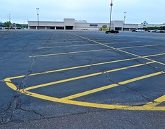 Under the 4 (Bobby Mou) Tags: cracking store economy truck asphalt lot mall parking decay retail