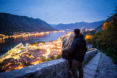 View over Kotor Bay (_gate_) Tags: kotor montenegro europe travel night bokeh sunset balkans gulf котор crna gora landscape sky view church the our lady rocks nikon d750 handheld hand held colorful beautiful summer spring may april mai 2017 sun set down sonnenuntergang adriatic sea meer adria euro trip wide light pink blue himmel cloud clouds wolken landschaft blendenstern stern star 20mm afs 18g ed nightscape cityscape urban wasser fluss see health