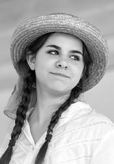 Over-her-shoulder Glance (wyojones) Tags: huntsville texas generalsamhiustonfolkfestival samhoustonmuseum smhouston girl woman singer musicalgrouphat dress ribbon look pretty lovely beauty brunette hair braids pigtails