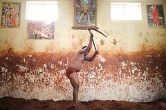 Indian mud wrestlers (slow paths images) Tags: india southasia indiansubcontinent southindia karnataka mysore kushti kusti indianmudwrestler pehlwani sports tradition akhara school man wall windows sirdi saibaba hanuman posters indoors texture training exercise travel
