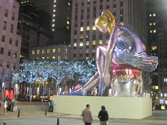 Seated Ballerina Mylar Balloon at Night 6243 (Brechtbug) Tags: seated ballerina mylar balloon night art sculpture by jeff koons 2017 rockefeller center nyc 30 rock new york city standing up above ice rink gold prometheus statue giant decoration ornaments 05202017 nights nite nites lights lites light oversize load ornament summer spring kids toy kitsch 60s toys sculptures statues pretty evening lobby plaza plant plants plastic artist