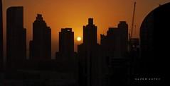 Skyline ... (Hazem Hafez) Tags: city skyscrapers dubai sunset skyline sun orange silhouette cityview