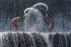 Water play (tmeallen) Tags: boys youth playing waterplay hammingitup throwingwater waterfall cascadingwater watertrails topofdam tukadundadam semarapura baliisland indonesia