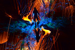 FireFlys. (martbarras) Tags: martbarras lightpainting lpuk lpwa nikon d7100 tokina 1116mm light art lightpaint lightpainter wirewool steelwool blue orange strobe torch silhouette camera rotation intentional movement woods trees bridge shoreham brighton darren hopkins flipflop fireflys biten