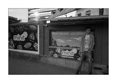 cigarette break [Bratislava] (Istvan Penzes) Tags: leicammonochromtyp246 penzes manualfocus rangefinder availablelight handheld bw black white bratislava slovakia leicasummicron35mmv1 street cigarettebreak