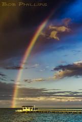 Bokeelia Stormy Sunset (tropicdiver) Tags: bokeelia florida pineisland clouds dock gulfofmexico pier pineislandsound rainbow southwestflorida storm stormyweather sunset