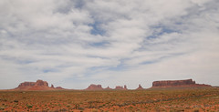 Monument Valley skyline (Vee living life to the full) Tags: nevada utah arizona distance layers limestone sandstone water evaporation disintegration weathering leger erosion roads route american vehicle rocks rock cliff sheer drop threat danger police mountains skyline horizon sitting geology sedimentary compression uplift wild road formation sky blue monuments valley death usa nationalpark long blackandwhite panorama