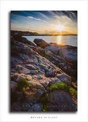 Bathed In Light (RTA Photography) Tags: brixham flare light sun sunset torbay devon southdevon rocks sea sky clouds portrait nikon d7000 sigma1020mm456exdchsm
