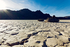 Here We Rest (matthewkaz) Tags: theracetrack rock rocks stone stones racetrackplaya racetrack drylake sailingstone sailingstones mountains inyomountains inyocounty deathvalley desert california 2014 flare lensflare sky clouds