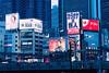 Shinjuku at Dusk (hidesax) Tags: shinjukuatdusk jr lines trains wires buildings skyscrapers ad billboard shinjuku tokyo japan hidesax leica m240 teleelmaritm 90mm f28