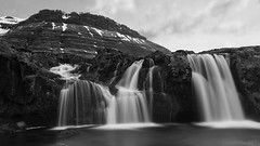 no greater enchantment than that of water (lunaryuna) Tags: iceland northwesticeland westfjords landscape panorama coast fjord mountainrange textures lowtide water reflections sky clouds cloudscape lightmood spring season seasonalchange boggrass thecolioursoficeland nature beauty solitude stillness lunaryuna blackwhite bw monochrome