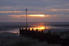 A bright patch in the sky before dusk (Kirkleyjohn) Tags: beach sunset sun clouds evening reflection reflet reflectionsinwater groyne norfolk