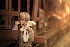 Goodbye (sveta_butko) Tags: boy train outside brown child warm toy little hold sad sadness childhood dream bunny holding one person