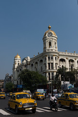 General Photos: India (Asian Development Bank) Tags: india ind calcutta kolkata westbengal bengal southasia metropolitanbuilding whitewaylaidlaw metropolitanlifeinsuranceco architecture baroque city urban cityscape urbandevelopment cars vehicles cabs taxis yellowcabs motorcycle motorbike landtransport publictransport street road roadcondition traffic trafficcondition people pedestrians motorists commuters