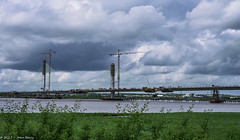 New Mersey Crossing from Wiggs Island (joanjbberry) Tags: newmerseycrossing runcorn bridge crane cheshire rivermersey landscape clouds
